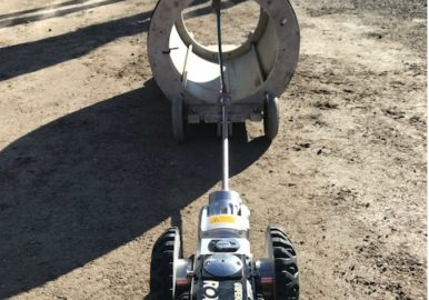 QuickLock trenchless repair rover being controlled remotely.