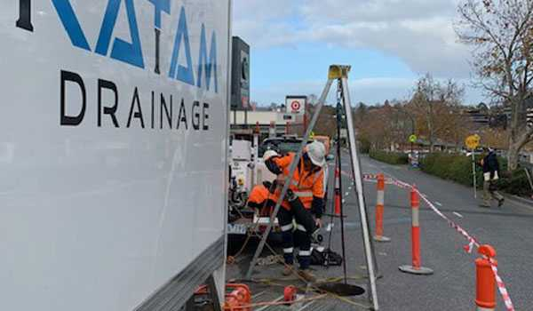 Katam Drainage staff performing confined space work in a Melbourne street.